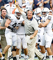 Penn State safety Ryan Keiser (23) and Penn State defensive coordinator Lee Roof, middle, celebrate the interception made by Penn State linebacker Michael Mauti (42) during the second half of an NCAA football game against Virginia Saturday Sept. 8, 2012 in Charlottesville, VA. Virginia defeated Penn State 17-16. Photo/Andrew Shurtleff)