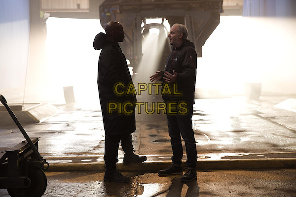 Mahershala Ali and Francis Lawrence (Director)<br /> on the set of The Hunger Games: Mockingjay - Part 1 (2014)<br /> *Filmstill - Editorial Use Only*<br /> CAP/NFS<br /> Image supplied by Capital Pictures