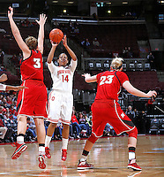Ohio State Buckeyes guard Ameryst Alston (14) makes a three point basket right before the end of the first half against Nebraska Cornhuskers forward Hailie Sample (3) and Nebraska Cornhuskers forward Emily Cady (23) at Value City Arena on February 20,  2014. (Chris Russell/Dispatch Photo)