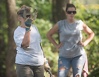NWA Democrat-Gazette/J.T. WAMPLER Joyce Clark of Hogeye lines up her shot while competing Sunday Sept. 6, 2015 against Ashley Day of Dardanelle at the Walker Park Horsehoe pits during the Arkansas Horseshoe Pitching Association's State Tournament.