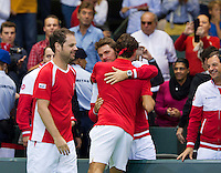 Switserland, Genève, September 20, 2015, Tennis,   Davis Cup, Switserland-Netherlands, Roger Federer (SUI) takes the deciding point for suisse and is congratulated by his team member Stan Wawrinka, left captain Severin Luthi<br /> Photo: Tennisimages/Henk Koster