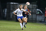26 September 2013: Duke's Lizzy Raben (6) and Virginia's Danielle Colaprico (24). The Duke University Blue Devils hosted the University of Virginia Cavaliers at Koskinen Stadium in Durham, NC in a 2013 NCAA Division I Women's Soccer match. Virginia won the game 3-2.
