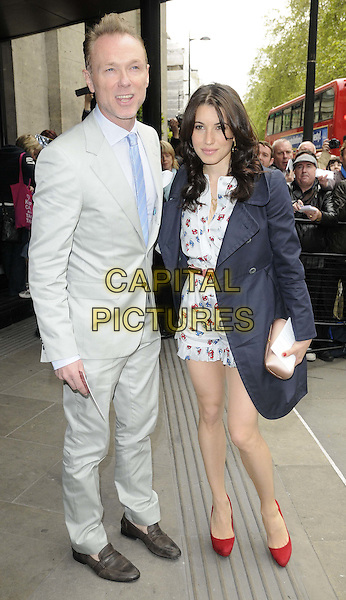 Gary Kemp & Lauren Kemp.The Ivor Novello Awards 2012, Grosvenor House Hotel, Park Lane, London, England..May 17th, 2012.full length grey gray suit blue tie jacket playsuit white print married husband wife red shoes .CAP/CAN.©Can Nguyen/Capital Pictures.