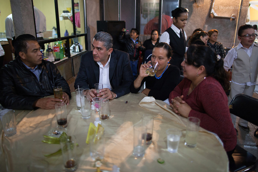 "Donovan sits with his wife and relatives at the wedding party of his sister-in-law in Iztapalapa, Mexico on October 31, 2015. Donovan Tavera, 43, is the director of ""Limpieza Forense México"", the country's first and so far the only government-accredited forensic cleaning company. Since 2000, Tavera, a self-taught forensic technician, and his family have offered services to clean up homicides, unattended death, suicides, the homes of compulsive hoarders and houses destroyed by fire or flooding. Despite rising violence that has left 70,000 people dead and 23,000 disappeared since 2006, Mexico has only one certified forensic cleaner. As a consequence, the biological hazards associated with crime scenes are going unchecked all around the country. Photo by Bénédicte Desrus"