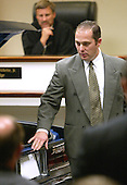 Wynn Gregory Warren, an United States Federal Bureau of Investigation (FBI) visual information specialist points to a hole in a model of the trunk lid cut in the trunk of the Chevrolet Caprice that sniper suspect John Allen Muhammad was captured in during court proceedings in Virginia Beach Circuit Court in Virginia Beach, Virginia, November 6, 2003.  Prince William County (Virginia) Circuit court judge LeRoy Millette, Jr., watches in the background. <br /> Credit: Tracy Woodward - Pool via CNP
