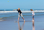 Princesses Amalia and Alexia play with a ball  during a photo session on the beach near Wassenaar, the Netherlands, July 10, 2015. © Michael Kooren