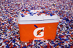 A Gatorade cooler sits on a pile of confetti on the turf during a post game celebration after the Green Bay Packers beat the Pittsburgh Steelers during Super Bowl XLV on Sunday, February 6, 2011, in Arlington, Texas. The Packers won 31-25. (AP Photo/David Stluka)