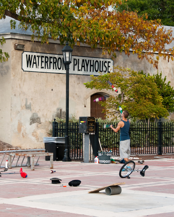 A juggler practices his trade before the evening crowds arrive for sunset at Duval Square, Key West, Florida, USA.