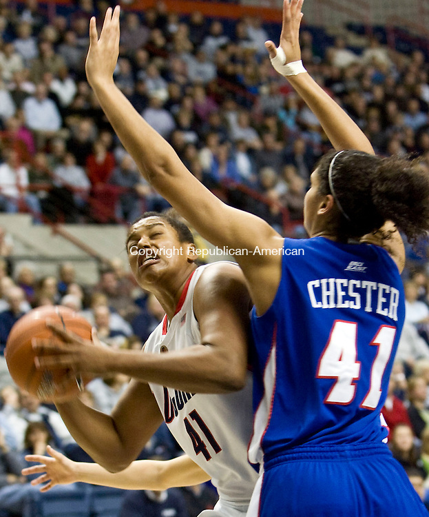 STORRS, CT - 13 JANUARY 2009 -011309JT08-<br /> UConn's Kaili McLaren tries to get past DePaul's Felicia Chester during Tuesday's game at Gampel Pavilion in Storrs. UConn won, 77-62.<br /> Josalee Thrift / Republican-American