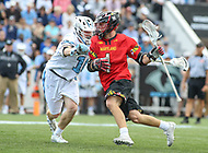 Baltimore, MD - April 28, 2018: Maryland Terrapins Connor Kelly (1) runs past a Johns Hopkins Blue Jays defender during game between John Hopkins and Maryland at  Homewood Field in Baltimore, MD.  (Photo by Elliott Brown/Media Images International)
