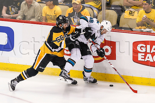 June 1, 2016:  San Jose Sharks center Tomas Hertl (48) tries to control puck as Pittsburgh Penguins defenseman Kris Letang (58) defends during the San Jose Sharks and Pittsburgh Penguins NHL Stanley Cup playoff game at Consol Energy Center in Pittsburgh, PA. Pittsburgh beat San Jose in overtime, 2-1.