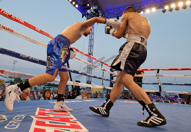 "Oscar ""Chapito"" Vasquez, from Reno, NV, (blue shorts) fights Jose Toribio, from San Diego, CA, (black shorts) in the Flyweight division of the 2015 Rural Rumble held at the Churchill County Fairgrounds in Fallon, Nevada on Saturday, August 22, 2015.  Vasquez won the bout with a 7th round knockout."
