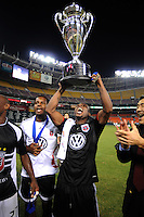 DC United defender Gonzalo Martinez (23) lifts the Lamar Hunt US. Open Cup after the win, DC United defeated The Charleston Battery 2-1, to win the  Lamar Hunt U.S. Open Cup at RFK Stadium in Washington DC, Saturday September 3, 2008.