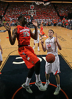 Syracuse forward Rakeem Christmas (25) dunks the ball next to Virginia forward/center Mike Tobey (10) during an NCAA basketball game Saturday March 1, 2014 in Charlottesville, VA. Virginia defeated Syracuse 75-56.