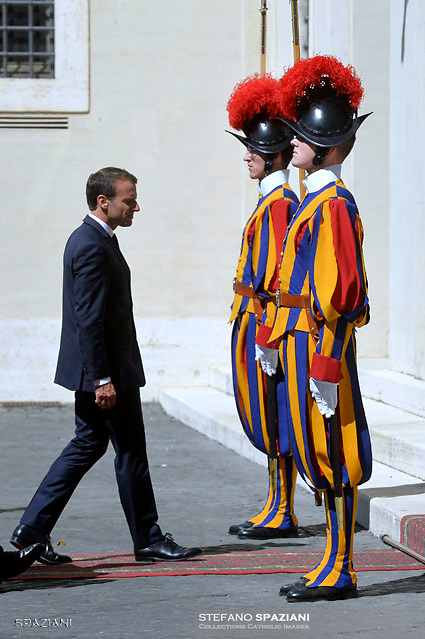 French President Emmanuel Macron is welcomed by Archbishop Georg Gaenswein as he arrives for the meeting with Pope Francis at the Vatican, June 26, 2018.