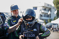 Nov 10, 2017; Pomona, CA, USA; NHRA funny car driver Alexis DeJoria is helped with her safety gear by husband Jesse James during qualifying for the Auto Club Finals at Auto Club Raceway at Pomona. Mandatory Credit: Mark J. Rebilas-USA TODAY Sports