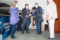 Former Virginia governor and Republican presidential candidate Jim Gilmore greets Augustin Barrios Gomez, Mexican politician and Deputy of the LXII Legislature of the Mexican Congress for the Federal District, at the Radisson Hotel's Radio Row in Manchester, New Hampshire, on Mon., Feb. 8, 2016. Many television and radio stations set up in the hotel for their coverage of the primary in the final days of the campaign. Gilmore finished in last place among major Republican candidates still in the race with a total of 150 votes.
