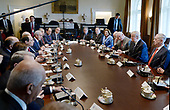 United States President Donald Trump speaks as President Abdel Fattah Al Sisi of Egypt  sits on the opposite side of the table with their respective delegations in the Cabinet Room of White House in Washington, DC, April 3, 2017.<br /> Credit: Olivier Douliery / Pool via CNP