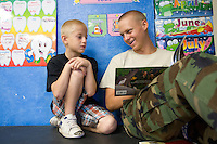 mr-cadets0530   159009- Project Challenge cadet  Michael Jensen reads to Sequoia Charter student Harrison Busby.  Jensen helps kids in the school's K-2nd grade class learn to read. Arizona Project Challenge, in Queen Creek, provides a live-in military based education for high school drop outs.  Michael Jensen, of Gilbert, will be the first Arizona Project Challenge cadet to graduate with a high school diploma from Sequoia Choice Arizona Distance Learning in Mesa. (Pat Shannahan/ The Arizona Republic)