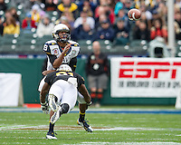 SAN FRANCISCO, CA - December 29, 2012: Navy quarterback Keenan Reynolds (19) gets hit as he releases the ball during the Navy Midshipmen vs the Arizona State Sun Devils in the 2012 Kraft Fight Hunger Bowl at AT&T Park in San Francisco, California. Final score Navy 28, Arizona State 62.