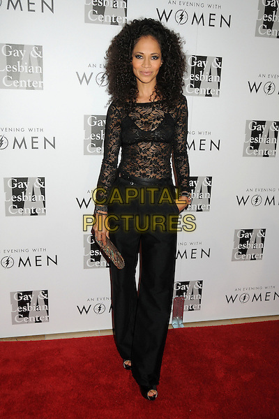 "Sherri Saum.LA Gay & Lesbian Center's ""An Evening With Women"" 2013 held at the Beverly Hilton Hotel, Beverly Hills, California, USA, 18th May 2013..full length black lace bra see thru through  top trousers .CAP/ADM/BP.©Byron Purvis/AdMedia/Capital Pictures"