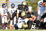 Palos Verdes, CA 10/20/11 - Troy Paolucci (Peninsula #55), Luke Morrow (Peninsula #33) and unidentified Peninsula player(s) in action during the Leuzinger vs Peninsula JV football game.