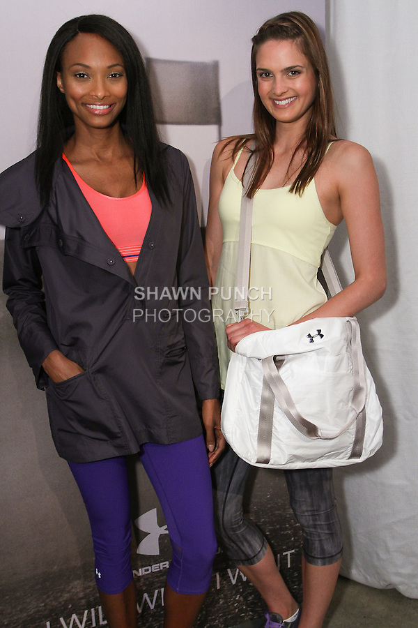 """Models pose in athletic gear during the Under Armour, """"I will what I want"""" global women's campaign launch, on July 31, 2014, in New York City."""
