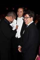 George Michael, David Walliams and Michael McIntyre enjoying a laugh at Elton John's White Tie and Tiara Ball