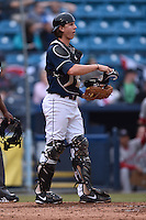 Asheville Tourists catcher Robbie Perkins (5) during game one of a double header against the Greenville Drive on April 18, 2015 in Asheville, North Carolina. The Tourists defeated the Drive 2-1. (Tony Farlow/Four Seam Images)
