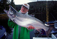 Angler holds a 24-1/2 pound silver salmon, (Coho), caught near Namu, British Columbia, Canada fishing from the M.V. Perry of Westwind Tugboat Adventures.