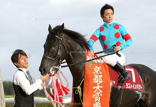Last Impact (Yuga Kawada),<br /> OCTOBER 14, 2014 - Horse Racing :<br /> Jockey Yuga Kawada poses with Last Impact after winning the Kyoto Daishoten at Kyoto Racecourse in Kyoto, Japan. (Photo by Eiichi Yamane/AFLO)
