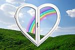 Rainbow behind a heart-shaped window