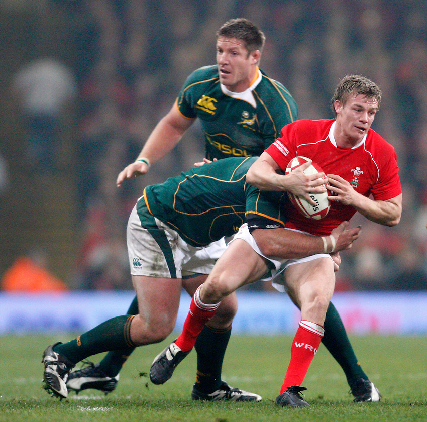 Photo: Richard Lane/Richard Lane Photography..Wales v South Africa. Prince William Cup. 24/11/2007. .Wales' Dwayne Peel is tackled.