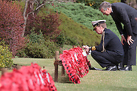 Captain Willem Vermeule, the Dutch Defence Attaché to Japan.(left) and deputy secretary general Mr. van Poelgeest (standing) lay a wreath of poppies during the Remembrance Day ceremonies at the Commonwealth War Cemetery in Hodogaya, Yokohama, Japan. Wednesday November 11th 2015