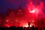 Liverpool fans create a smokey atmosphere as the team coaches arrive  during the UEFA Champions League match at Anfield, Liverpool. Picture date: 11th March 2020. Picture credit should read: Darren Staples/Sportimage