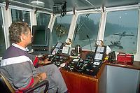 "- pusher of ""Fluviopadana"" company with barges in navigation on the Po river, the bridge....- spintore della compagnia ""Fluviopadana"" e chiatte in navigazione sul fiume Po, plancia di comando"