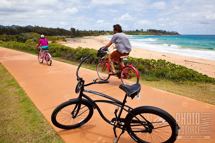 A tourist couple riding on the Kapaa bike path