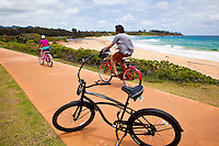 A tourist couple riding on the Kapaa bike path
