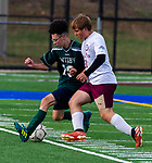 WATERBURY,  CT-101619JS19-  Wilby's Alex Alicia (19) and Sacred Heart's Michael Marchetti (21) each try to get control of the ball during their NVL game Thursday at Municipal Stadium in Waterbury. <br />  Jim Shannon Republican-American