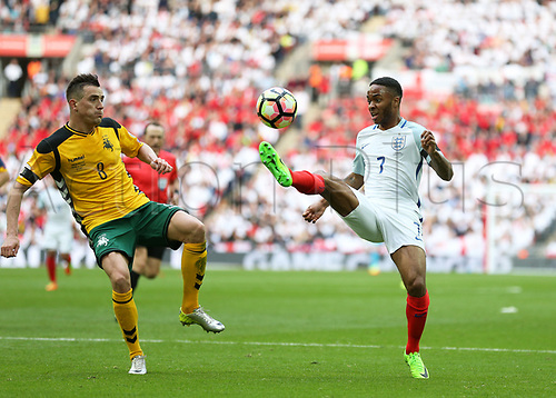 March 26th 2017, Wembley Stadium, London, England; World Cup 2018 Qualification football, England versus Lithuania; Raheem Sterling of England in action with Egidijus Vaitkunas of Lithuania marking