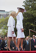 First lady Melania Trump and Mrs. Brigitte Macron of France depart after listening to speeches during a state visit to The White House in Washington, DC, April 24, 2018. Credit: Chris Kleponis / Pool via CNP