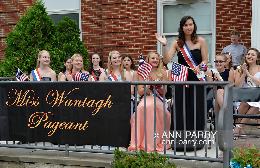 Wantagh, New York, USA. July 4, 2015. KERI BALNIS, at extreme left, and other present and past contestants of The Miss Wantagh Pageant ceremony, a long-time Independence Day tradition on Long Island, are introduced to the audience in front of Wantagh School. Balnis was crowned Miss Wantagh 2015. Since 1956, the Miss Wantagh Pageant, which is not a beauty pageant, crowns a high school student based mainly on academic excellence and community service.