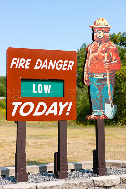 A fire danger sign with Smokey the Bear shows a danger level of low in High Point State Park, Sussex County, New Jersey.