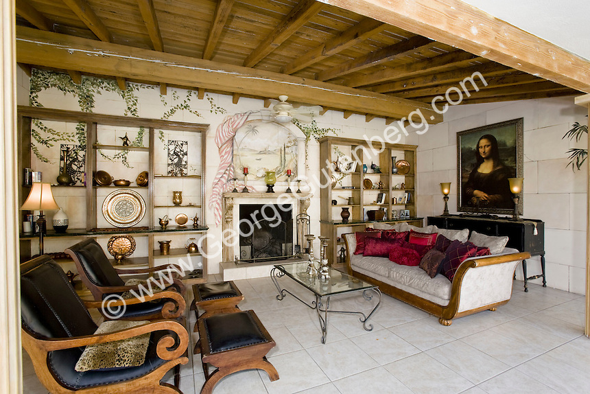 Spanish style living room with wood beam ceiling set on outside patio