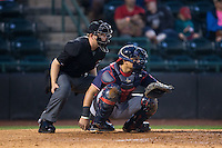Rome Braves catcher Jonathan Morales (8) sets a target as home plate umpire Ryan Powers looks on during the game against the Hickory Crawdads at L.P. Frans Stadium on May 12, 2016 in Hickory, North Carolina.  The Braves defeated the Crawdads 3-0.  (Brian Westerholt/Four Seam Images)