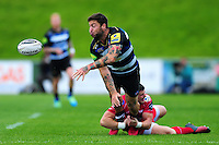 Matt Banahan of Bath Rugby offloads the ball after being tackled. Pre-season friendly match, between the Scarlets and Bath Rugby on August 20, 2016 at Eirias Park in Colwyn Bay, Wales. Photo by: Patrick Khachfe / Onside Images