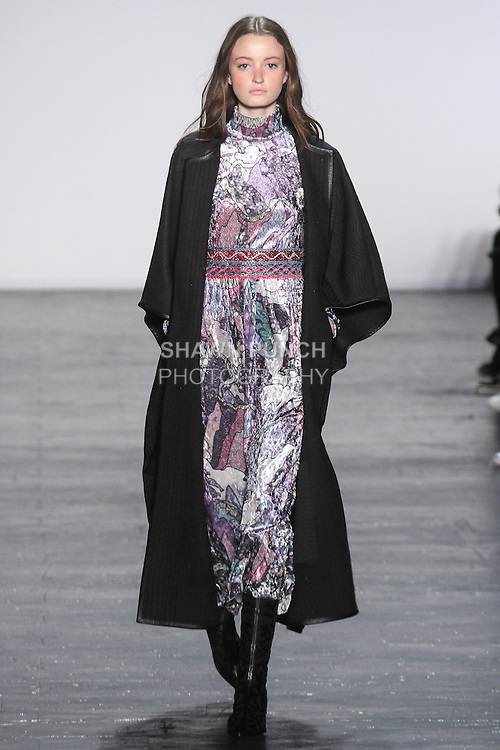 "Model Megan walks runway in a dreamscape motif velvet midi dress, with a quilted jacquard coat in black, from the Vivienne Tam Fall Winter 2016 ""Cultural Dreamland The New Silk Road"" collection, presented at NYFW: The Shows Fall 2016, during New York Fashion Week Fall 2016."