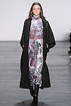 """Model Megan walks runway in a dreamscape motif velvet midi dress, with a quilted jacquard coat in black, from the Vivienne Tam Fall Winter 2016 """"Cultural Dreamland The New Silk Road"""" collection, presented at NYFW: The Shows Fall 2016, during New York Fashion Week Fall 2016."""
