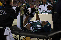 12 December 2004: Terrell Owens gets his back and legs worked on after taking a hard hit from Sean Taylor.<br />