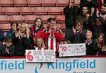 Fans hold up banners requesting shirts during the championship match at the Bramall Lane Stadium, Sheffield. Picture date 28th April 2018. Picture credit should read: Simon Bellis/Sportimage